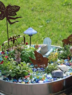 LOVE the colored rocks and I've GOT to find that little owl!!   sweet fairy garden