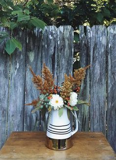 pitcher perfect filled with fall blooms! (via @ flowersbymilkandhoney's instagram)