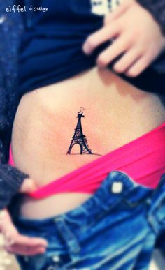 A little eiffel tower tattoo on the hip. I'd consider this. But smaller, and only black.