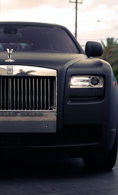 Matte Black Rolls Royce Ghost.