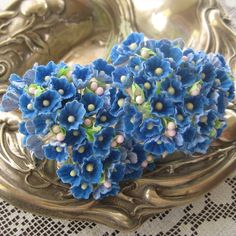 Old fashioned flocked forget me not millinery flowers