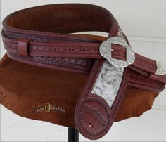 Want! -- Fully tooled, padded and lined with inlaid cowhide panel, this beautiful strap features a silver buckle set and a custom fit. Can also be made in black. $275