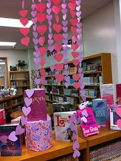 Paper heart garland book display for February in the library.