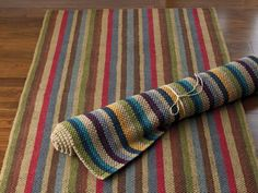 {DIY Striped Jute Rug} Use jute or sisal. Make sure to vacuum it thoroughly before painting. Use blue painter's tape to make stripes or designs.  Paint with a medium, natural-bristle paintbrush. Latex paint or craft paint works well for this project, but make sure to lay it on thick: natural fibers absorb paint quickly. Two or more coats may be necessary to achieve the right color, let the coats dry in between. Choose a paint with some sheen for clean-ability.