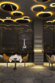 Ciel_de_Paris_restaurant  - high up the Paris skyline you have the Ciel De Paris restaurant, with its futuristic interior design and finishes.  Lighting playing a critical part in the creation of this ' beam me up Scottie' venue.