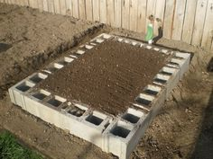 Cinder Block Raised Garden Bed- plant ur choice of short flowers or food plant (strawberries, onion, pansies, marigold, etc…) in cinder block center to add ur special touch… don't forget to lay card- board inside garden area before dirt to kill grass & weeds naturally