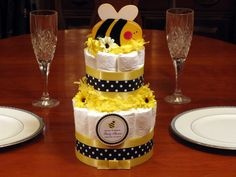 diaper cake idea for centerpiece...don't even need the bee on top- top it was more yellow thingies or yellow flower :)