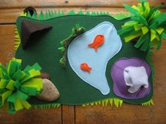 Felt jungle from plum pudding-- I think it would be great for teaching about ecology/biology to have various habitats: desert, jungle, mountain, etc.  Excellent teaching/playing resource