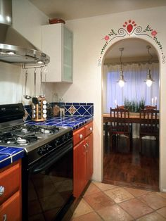 Handpainted Inspiration Handpainted tiles and archway provide authenticity for this Mexican style kitchen.  Design by Erica Islas