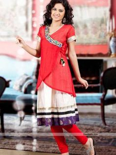 Traditional angrakha pattern tunic designed with double layers. Light pleated white inner layer and red outer layer is looking beautiful, with tassel and border. You can wear it with matching leggings. http://goodbells.com/kurtis/designer-off-white-and-red-shade-tunic-kurti.html