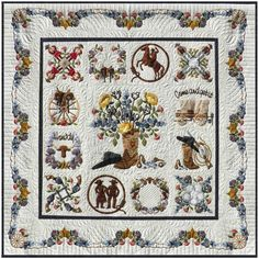 "Happy Trails, 70 x 70"", album style quilt by Pearl P. Pereira at P3 Designs.    The 24"" center block is surrounded by twelve 12"" blocks.   The  finishing touch is the barbed wire swag border filled with roses, purple sage, blue bonnets, wagon wheels and  stars."