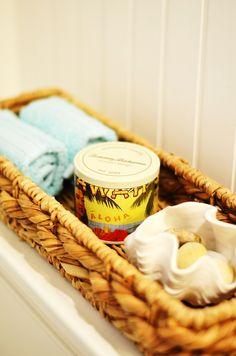 Coastal bathroom decor! Woven basket and washcloths are @HomeGoods finds. #HomeGoodsHappy