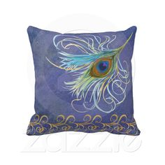 Peacock Dreams American MoJo Pillows  Beautiful Peacock Dreams 20x20 throw pillow will add a splash of color to any room with the soft watercolor background in blues, purples and lavenders accented with a large watercolor peacock feather and swirling golden border. Full color printing on both sides!