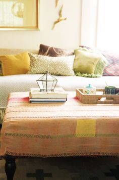 Create a simple reversible ottoman cover from a Kantha quilt