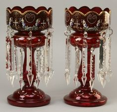 "Pair of late 19th century ruby red Moser glass lusters with cut crystal prisms, and hand decorated with enameled floral overlays and gold gilt designs, 14""h."