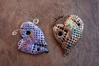 On Beading Daily, this is a free, exclusive polymer clay project from Iris Weiss, the Education Manager of Polyform Products (maker of Sculpey and Premo clay). These beautiful Mashed Up Hearts can be used as either pendants or pins!