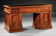 Sold for $1,900 in July 2012    An American Renaissance Walnut and Burled Wooten Desk, inset oilcloth top, three drawers and slide on one side, two drawers on the opposite side, rotary storage cabinet base, one side for files, other with cubbyholes, molded base, height 31 1/2 in., width 59 1/2 in., depth 28 3/4 in