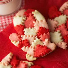 Day Four: Cut out little pieces of colored #cookie dough with a fluted pastry wheel, overlap them to create a pattern, and use a mitten-shaped cookie cutter to cut out dough to make these adorable patchwork mitten cookies.  #25DaysOfChristmasCookies