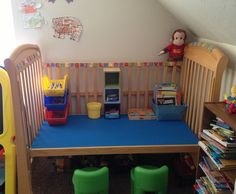 Drop side crib made into desk for child