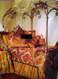 Gold painted wrought iron canopy bed