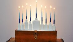 DIY menorah - made out of perfume bottles, paint and candles! #DIY #hanukkah #chanukah