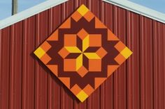 orange on red barn, American Quilters Society article.