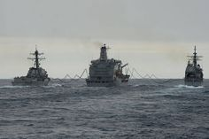U.S. ships conduct an underway replenishment. by Official U.S. Navy Imagery, via Flickr