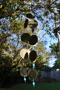 Recycled tin can wind-chime. I will paint them and hang them by the playhouse. :)