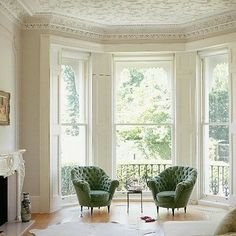 lacy ceiling, green chairs