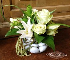 golf themed party floral centerpiece with all white and green flowers