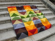 Lovely lovely colors in this large-scale flying geese quilt by Darcy Childress of Modern Cozy.