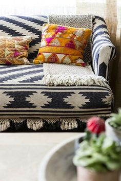 """This is one of the most talked about pieces in my home when people visit. It is a small settee made from vintage kilim rugs. The details are insane. Can you see all those little tassels at the bottom? The throw was brought back from my travels in Mexico and the pillows are made from vintage wedding cloths from India. I love every little detail about this corner of the room."""