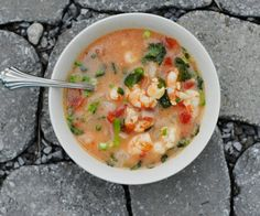 Cilantro Coconut Shrimp Soup:    1½ pound wild shrimp  1 onion, chopped  3-4 garlic cloves, minced or chopped  1 tbsp coconut oil  1 cup coconut milk  4 cups water  ½ cup cilantro  1 can diced tomatoes  1 lemon, juiced  cayenne pepper, dash  ½ tbsp salt  scallions