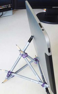 DIY iPad Stand: this is awesome! I needed an easel-like stand and this is perfect in a pinch.