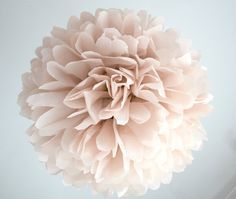 gorgeous pale pink poms to hang from the nursery ceiling
