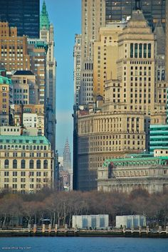 Broadway (Canyon of Heroes), Woolworth Bldg and the Chrysler Building back at 42nd Street. View from the Staten Island Ferry