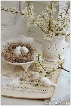 spring decoration.  Love using birds in decor this spring . would look great on a table with white dishes