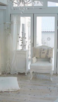Shabby Chic, just so clean! It would never work in my house. HA!