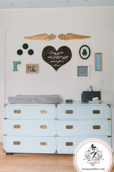 Eclectic gallery wall + campaign dresser as changing table = NURSERY LOVE! #nursery #nurserydecor #gallerywall