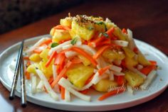 Simply So Good:  Fresh pineapple salad with pickled jicama and carrots.