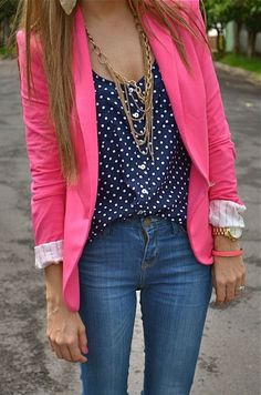 Polka dot shirt, pink blazer, gold necklaces