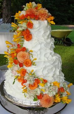 Beautiful orange flowered wedding cake!