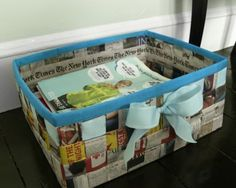 A basket made from old newspapers and a little ribbon.