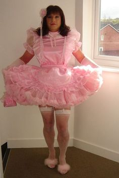 Sissy Hypnosis a beautiful sissy maid hypnotized into wearing a baby pink satin sissy maid dress.
