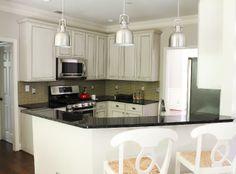 resurfaced builder's grade cabinets. Kitchen by Erika Ward Interiors