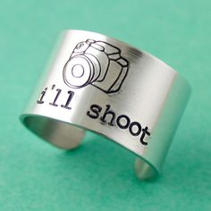 Perfect for the photographer! This is a 1/2 adjustable aluminum ring stamped in with our camera design stamp and the phrase Ill shoot. This ring $18 Size 8 want: 5/10