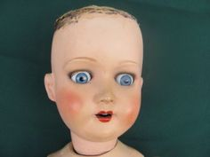 Ball jointed dolls are some of the creepiest toys known to man. This one's a vintage German one going for $10.00 on eBay- snatch it up quick!