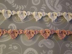 Lacy crochet hearts made with bobble stitches and a variety of basic stitches ~ free pattern