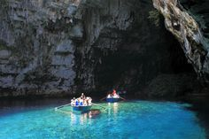 Rowing through a cave in Kefalonia, Greece.