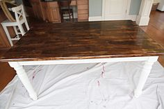 wow - I have exactly the same table - the original top is much lighter wood finish.  I want to use mine for the new eat-in kitchen but it needs an upgrade.  I was thinking of doing a shiny white top and blue legs.  which is better?